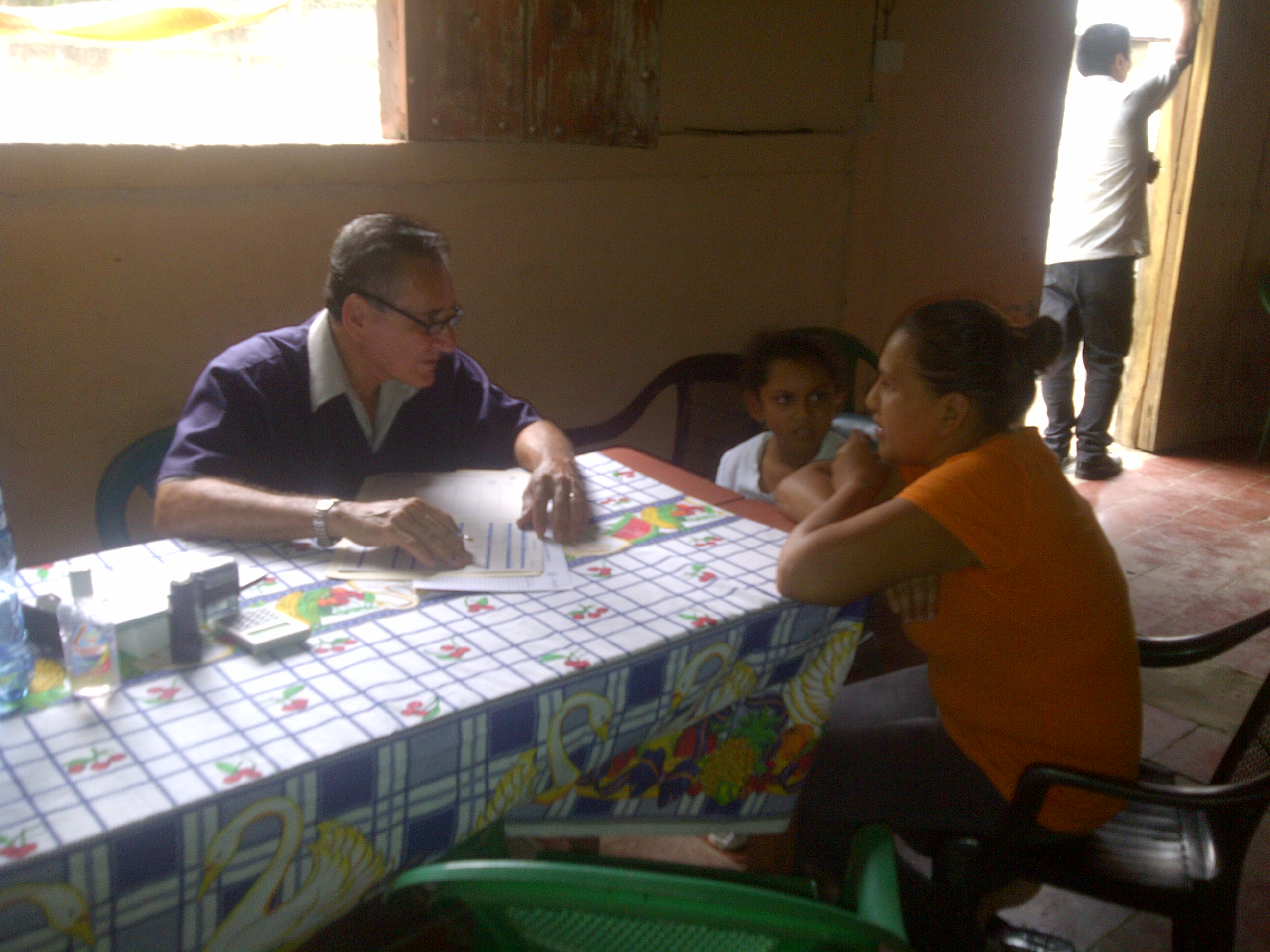 Dr. Juarez, a contracted Nicaraguan doctor, consults with a mother and her child